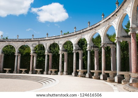 VERSAILLES, FRANCE - OCTOBER 1: Gardens of Versailles Palace on October 1, 2011 in Versailles. The Palace of Versailles is a royal chateau with beautiful gardens and fountains. - stock photo