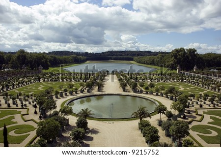 Versailles garden with fountaine and trees - stock photo