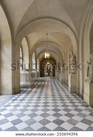 VERSAILLES - JULY 29: Part of the Great Palace on July 29, 2014 in Versailles, France. The palace was built in the northwestern part of the Domain of Versailles at the request of Louis XIV.