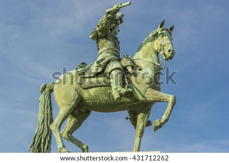 VERSAILLES, PARIS, FRANCE, EU - SEPTEMBER 27, 2013: equestrian statue of King Louis XIV at the main entrance of the palace