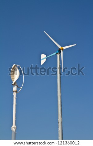 Vertical axis and normal wind turbine - stock photo
