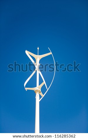 Vertical axis wind turbine against a clear deep blue sky - stock photo