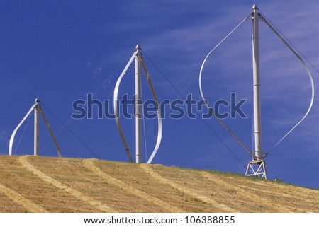 Vertical-axis wind turbines on hill