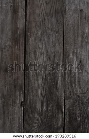 Vertical background from gray weathered old wood planks - stock photo