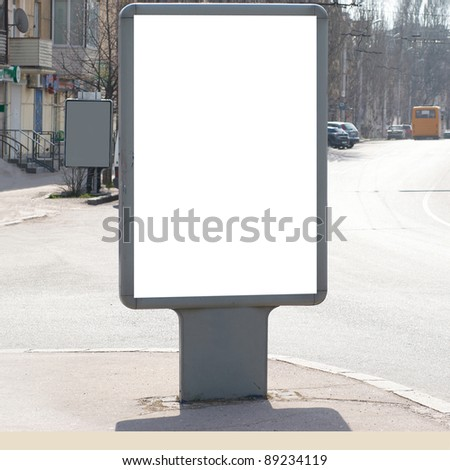 Vertical blank billboard on the city street - stock photo