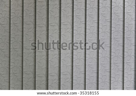 Vertical blinds textile pattern sun lit from behind - stock photo