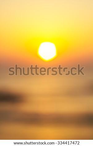 Vertical blured orange sunset background. - stock photo