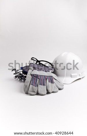 vertical centered PPE wrenches hard hat leather gloves safety glasses - stock photo