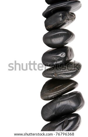 Vertical column of dark stones isolated in white