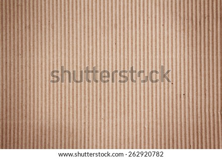 Vertical corrugated cardboard. Can be used as background or for a variety of designs. - stock photo