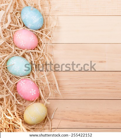 Vertical Easter egg border on a wood background - stock photo