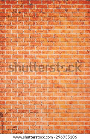 Vertical empty red brick wall textured background. - stock photo