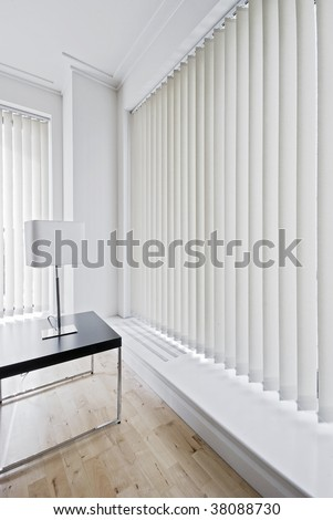 vertical fabric blinds on floor to ceiling windows - stock photo