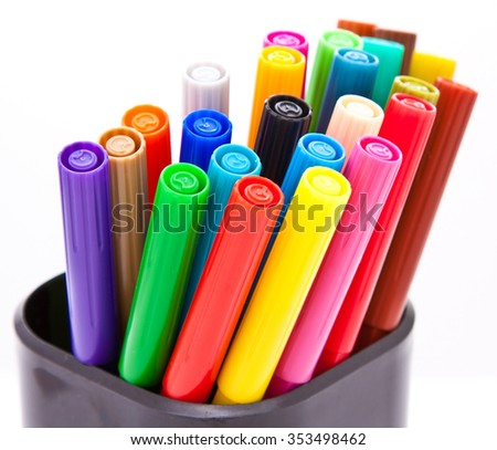 Vertical fragment or colorful closed markers; white background - stock photo