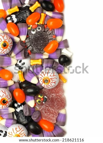 Vertical Halloween candy border over a white background  - stock photo