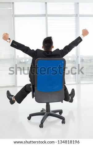 Vertical image of a businessman in a chair - stock photo