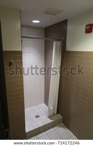 Vertical Image Of A Clean Shower Stall With Curtain.