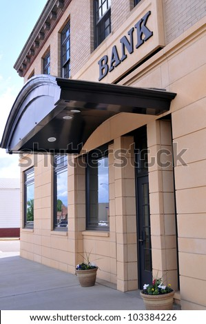 Vertical image of a covered entrance to a bank branch office in the United States
