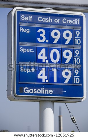 Vertical image of a $4 gas on a Mobil sign. - stock photo
