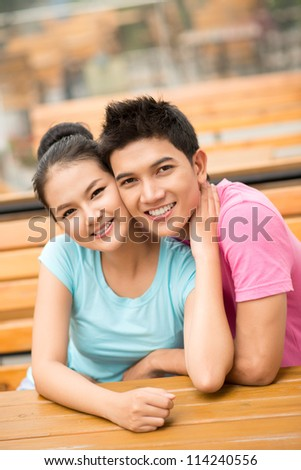 Vertical image of a happy young couple enjoying each other�¢??s company - stock photo