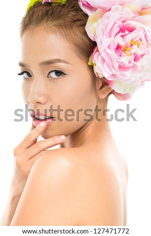 Vertical image of a sensual beauty looking at camera over the shoulder - stock photo