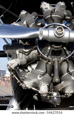 Vertical image of a shiny rotary aircraft engine on an old bi-plane. - stock photo