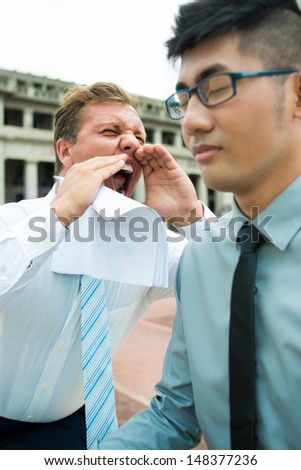 Vertical image of an emotional screaming businessman on the foreground - stock photo