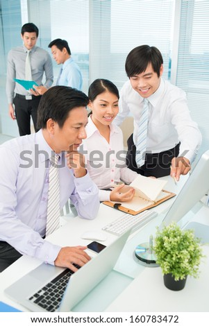 Vertical image of business briefing at the office on the foreground - stock photo
