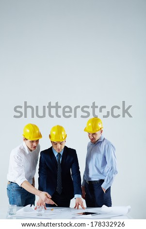 Vertical image of business colleagues discussing the plan at the meeting  - stock photo