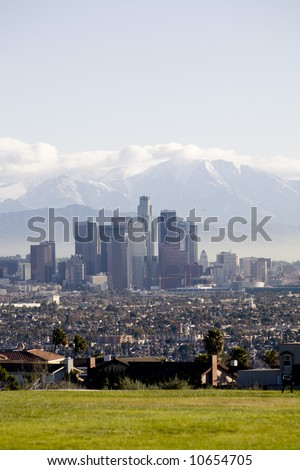 Vertical image of Downtown Los Angeles from a park overlooking houses