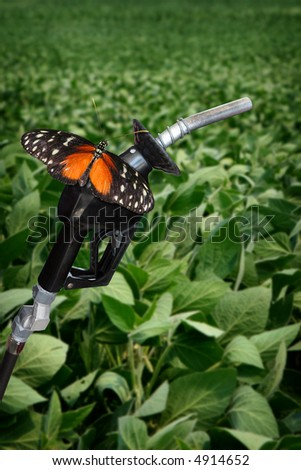 vertical image of orange butterfly on gasoline nozzle. - stock photo