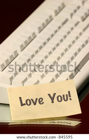 vertical love you message on the keyboard - stock photo
