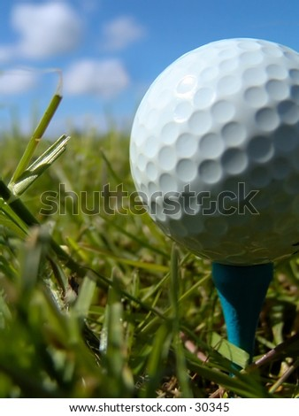 Vertical, low angle shot of golfball and peg - stock photo