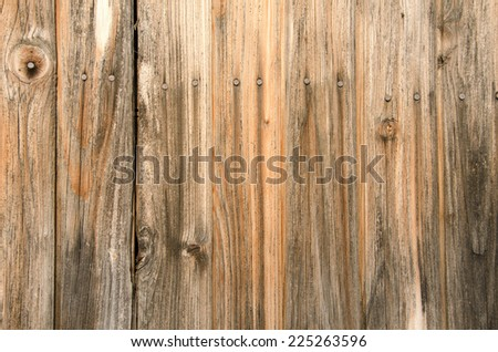 Vertical old wooden planks with nails background.