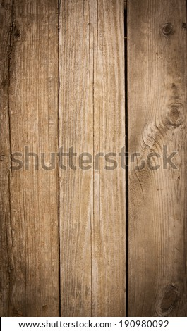 vertical orientation close up of weathered wooden boards in a warm finish, as a background or texture with copy space / Vertical Wooden Boards - stock photo