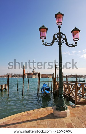 Vertical oriented image of street lamppost and Grand Canal in Venice, Italy. - stock photo