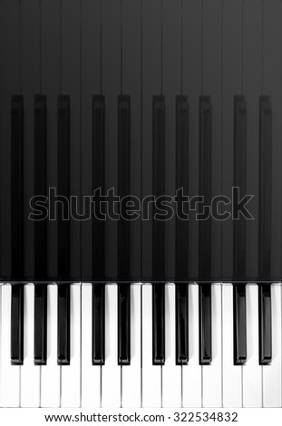 vertical photo of beautiful classical piano keys & reflection for music background - stock photo