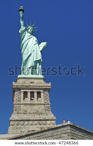 vertical photo of The Statue of Libery, clear blue sky - stock photo
