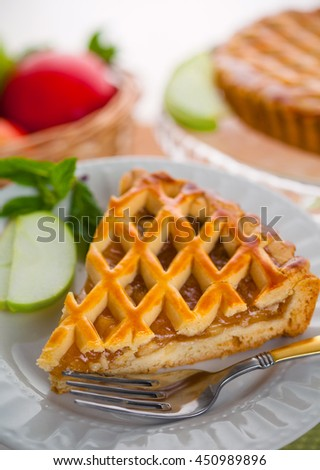 Vertical piece of american apple tart pie golden crust holiday dessert - stock photo
