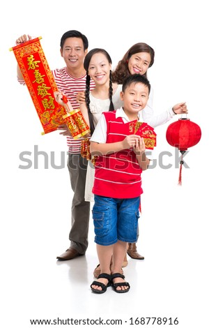 Vertical portrait of a cheerful family with red Tet symbolic isolated on white  - stock photo