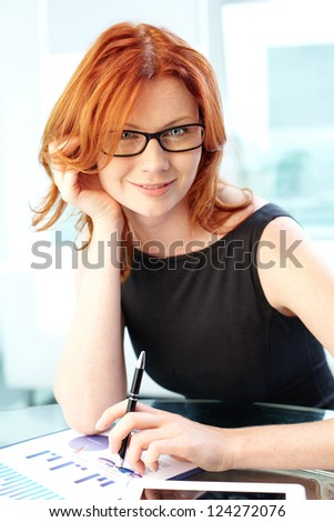 Vertical portrait of a gorgeous business lady dressed with elegance - stock photo