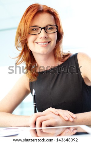 Vertical portrait of a gorgeous business lady dressed with elegance