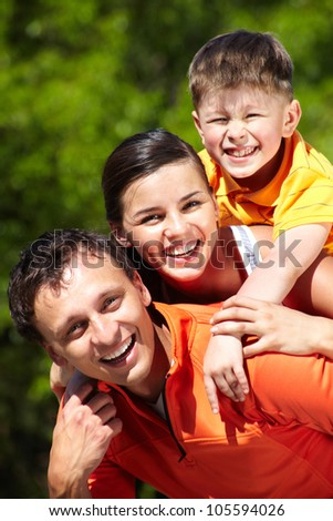 Vertical portrait of a playful smiling family - stock photo