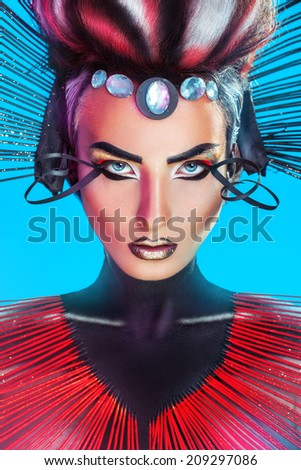 Vertical portrait of beauty adult caucasian female with creative makeup and hairstyle in studio - stock photo