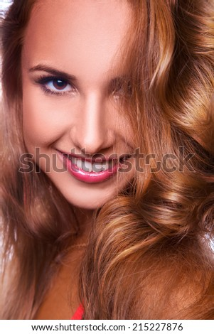 Vertical portrait of pretty young adult female in studio - stock photo