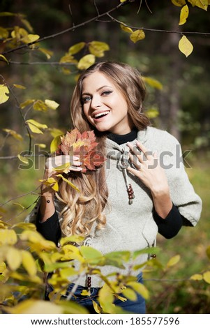 Vertical portrait of young woman looking into the camera with a smile on her face. - stock photo