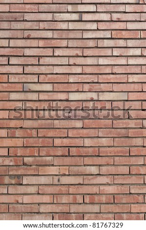 Vertical red brick wall texture. - stock photo