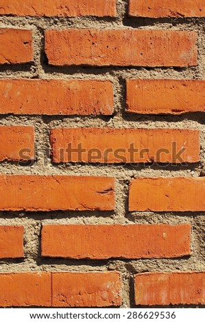 Vertical red bricks wall background - stock photo