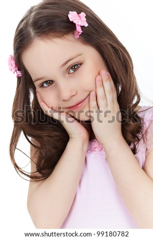 Vertical shot of a cute little girl smiling and posing in front of the camera - stock photo