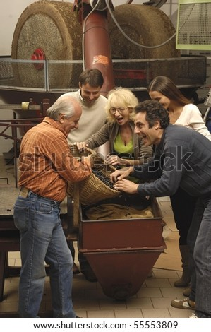 Vertical shot of a family working in a mill - stock photo